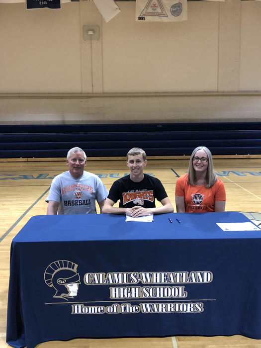 Max H. signing with parents to continue academic and athletic career
