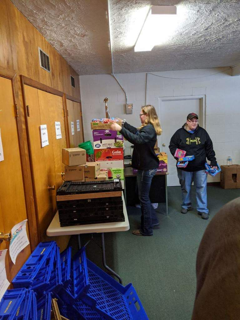 students helping unload groceries at St. Paul's