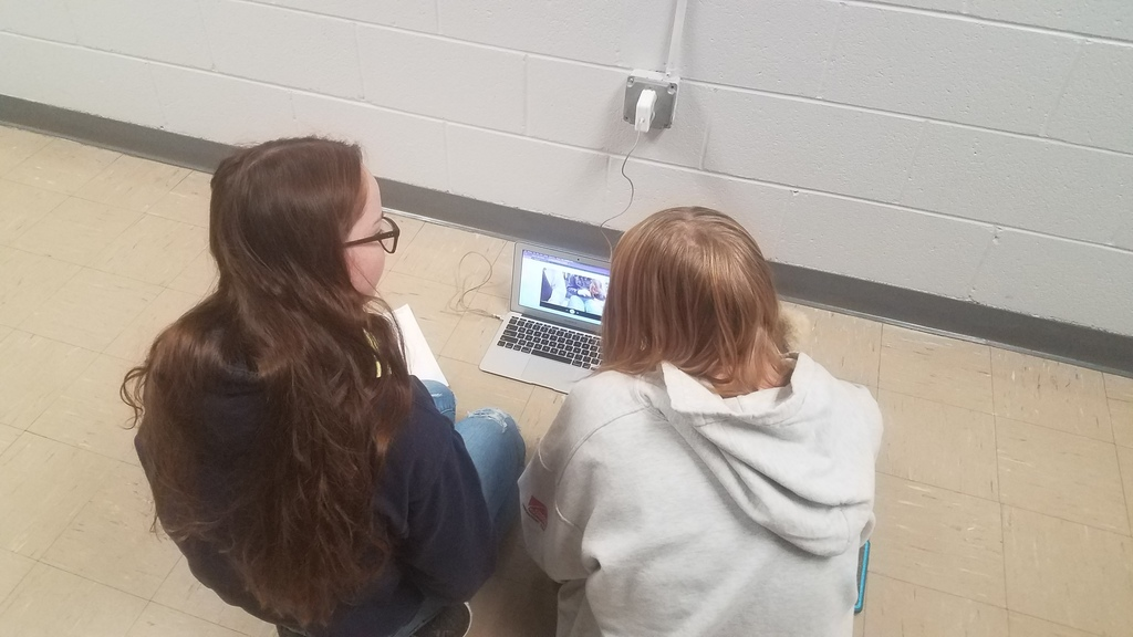 Students creating videos about how to solve rational equations.